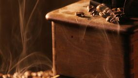 Coffee grinder with slow releasing the aroma of coffee beans stock video