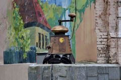 Coffee grinder on the street Royalty Free Stock Image