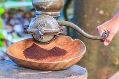 Coffee grinder. Traditional coffee grinder of Thailand stock photo