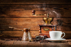 Coffee grinder, turk and cup of coffee Royalty Free Stock Images