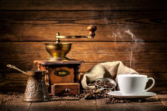 Coffee grinder, turk and cup of coffee Stock Image