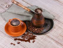 Coffee grinder, turk and cup of coffee Royalty Free Stock Photography