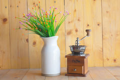 Coffee grinder. Vase of Flowers and vintage coffee grinder Royalty Free Stock Photos