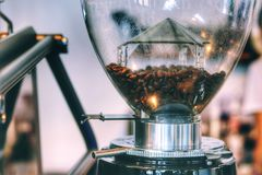 Coffee grinder and warm light in vintage style royalty free stock photography