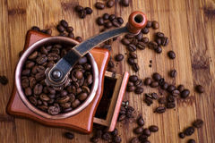 Coffee. Grinder on the wood table Royalty Free Stock Photography