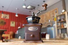 Coffee grinder on wood table in coffee cafe. Background Royalty Free Stock Photography