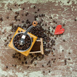Coffee grinder on wooden board Royalty Free Stock Photo