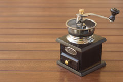Coffee Grinder. On the wooden table Stock Photography