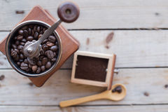 Coffee grinder on a wooden table Royalty Free Stock Images