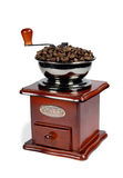 Coffee-grinder2. Coffee-grinder with coffee beans isolated on white,clipping path included Royalty Free Stock Photo