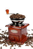 Coffee-grinder3. Coffee-grinder with coffee beans isolated on white Royalty Free Stock Photography