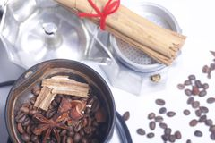 Coffee grinders, anise and cinnamon with other spices are covered in the coffee grinder. Next to it is a geyser coffee machine, di. Sassembled stock images