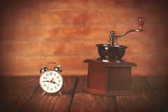 Coffee gringer and retro alarm clock Royalty Free Stock Photo