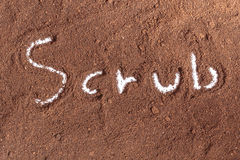 Coffee ground with scrub text Royalty Free Stock Photos