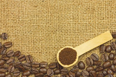 Coffee ground in spoon on coffee seeds Stock Image