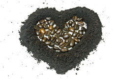 Coffee grounds and coffee bean, heart shape Stock Photo