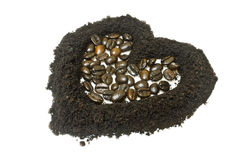 Coffee grounds and coffee bean, heart shape Stock Photography