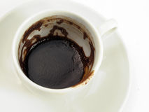 Coffee grounds in cup. Coffee grounds or dregs in the bottom of a white cup Stock Images