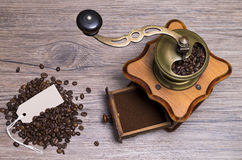 Coffee grounds with label. Image shows a coffee grinder with label from a top view stock photos