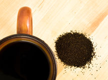 Coffee grounds with mug Royalty Free Stock Images