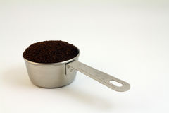 Coffee Grounds. Silver Heaping  Scoop of Coffee Grounds Royalty Free Stock Photos