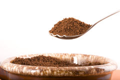 Coffee grounds on a spoon. Royalty Free Stock Photography