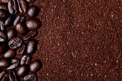 Coffee grounds and whole beans Royalty Free Stock Images