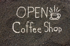 Coffee grounds write Open Coffee Shop, Open Label Royalty Free Stock Photography