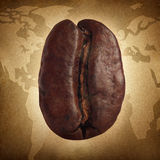 Coffee Grunge. Concept with a roasted natural bean seed for brewing espresso or cappuccino as a global natural food concept on a world map representing blend of Stock Images