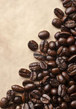 Coffee grunge background. Roasted coffee beans on grunge background Royalty Free Stock Images