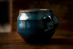 Coffee in grunge blue clay cup Stock Photos