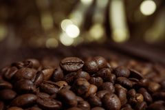 Coffee on grunge wooden background Fresh coffee beans on wood and linen bag, ready to brew delicious coffee. Coffee on grunge wooden background Fresh coffee Royalty Free Stock Photography