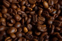 Coffee on grunge wooden background Fresh coffee beans on wood and linen bag, ready to brew delicious coffee Stock Photo