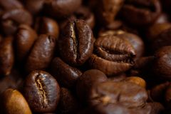 Coffee on grunge wooden background Fresh coffee beans on wood and linen bag, ready to brew delicious coffee. Coffee on grunge wooden background Fresh coffee Stock Photo