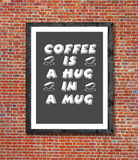 Coffee is a hag in a mug written in picture frame Royalty Free Stock Images