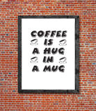 Coffee is a hag in a mug written in picture frame Royalty Free Stock Photography
