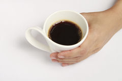 Coffee in hand. Stock Photos