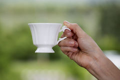 Coffee in hand Stock Photos
