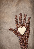 Coffee Hand holding cookie heart Royalty Free Stock Images