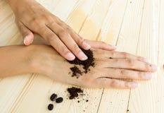 Coffee hand scrub with ground coffee and coffee beans Stock Photo