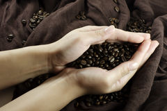 Coffee in hands Stock Image