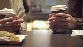 Coffee in hands in cafe stock footage