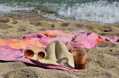 Coffee, Hat and Sun Glasses on Beach Stock Image