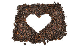 Coffee heart. Shape of heart made with coffee beans on white background Stock Photos