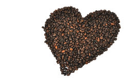 Coffee heart. Shape of heart made with coffee beans on white background Stock Photography