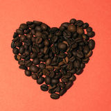 Coffee Heart. Beautiful roasted Coffee beans heart  on a red background Stock Photography