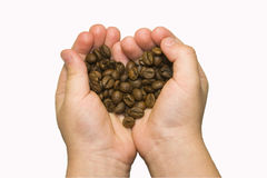 Coffee heart. In the hands of a child Stock Photography