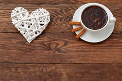 Coffee and heart as a token of love. Cordial meeting over coffee in the proof of eternal love Stock Photos