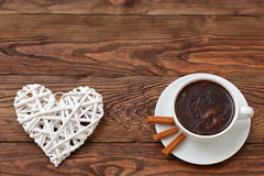 Coffee and heart as a token of love. Cordial meeting over coffee in the proof of eternal love Royalty Free Stock Image