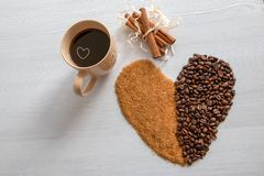 Coffee heart, with brown sugar and coffee in a cup. Coffee heart with brown sugar and coffee in a cup royalty free stock images